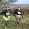Mark & Clare Kleanthous running towards the finish line of Major series 5 km March 2014
