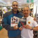Daley Thompson gets a copy of Triathlon The Mental Battle & The Complete Book of Triathlon Training