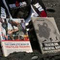 Official Ironman Book how to train & Triathlon The Mental Battle seen on Black sands beach Hawaii