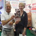 All smiles now she has a signed copy of The Complete Book of Triathlon Training