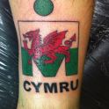 Max Williams did Ironman Wales in 2012, he is welsh so had the M-Dot with country flag = Cymru is Wales in welsh.