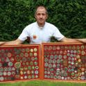 IronMate Photo - Mark With Just Some Of His Triathlon Medals
